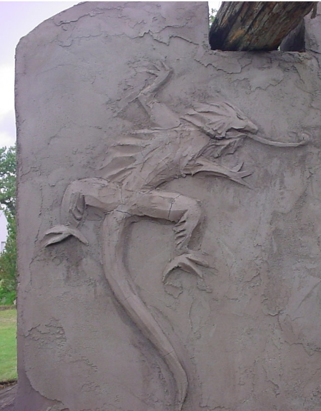 iguana stucco relief carving