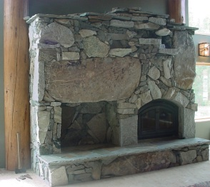 stone fireplace with wood storage
