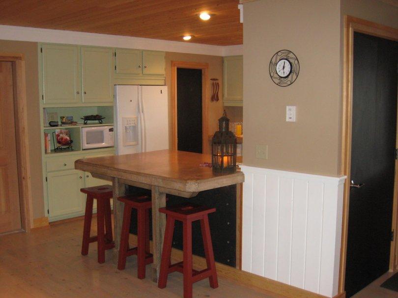 concrete countertop and wide-plank floor