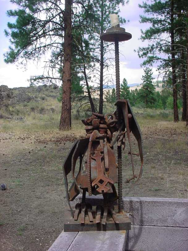 Monk Bird sculpture